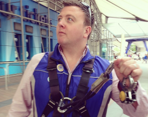 phil looking masterful, about to climb the millennium dome